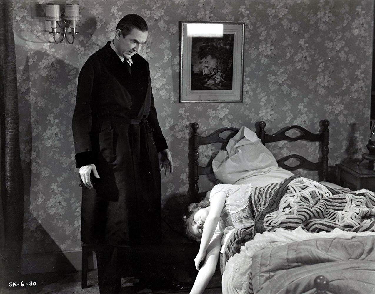 Dr Lorenz (Bela Lugosi) stands over unconscious wife Elizabeth Russell in The Corpse Vanishes (1942)