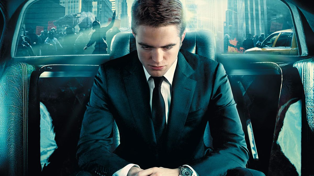 Eric Packer (Robert Pattinson) drifts through a collapsing world in his limousine in Cosmopolis (2012)