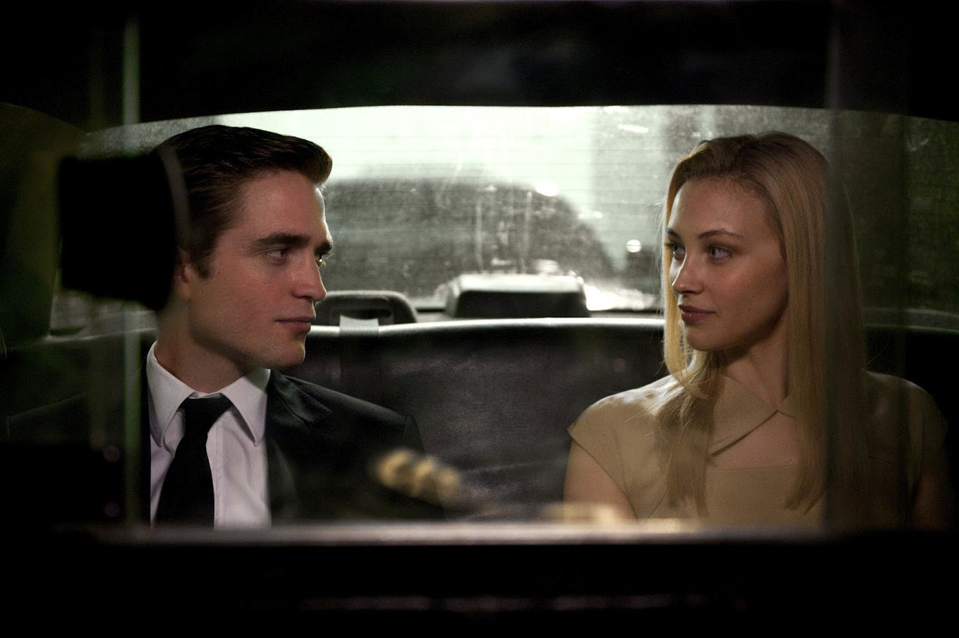 Robert Pattinson and wife Sarah Gadon in Cosmopolis (2012)