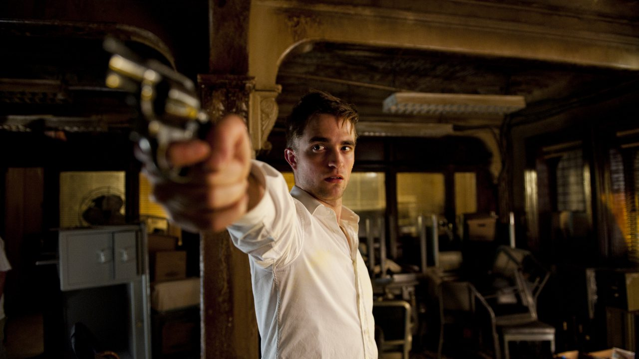 Robert Pattinson with handgun in Cosmopolis (2012)
