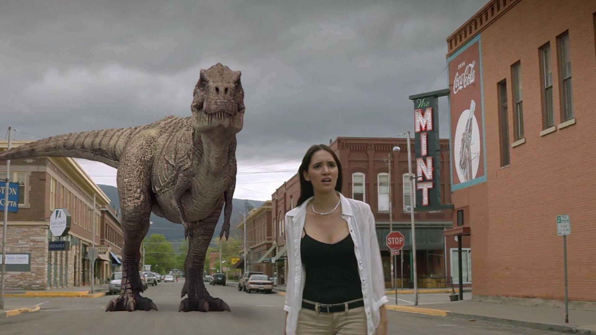 Sara Malakul Lane and dinosaur in Cowboys vs. Dinosaurs (2015)
