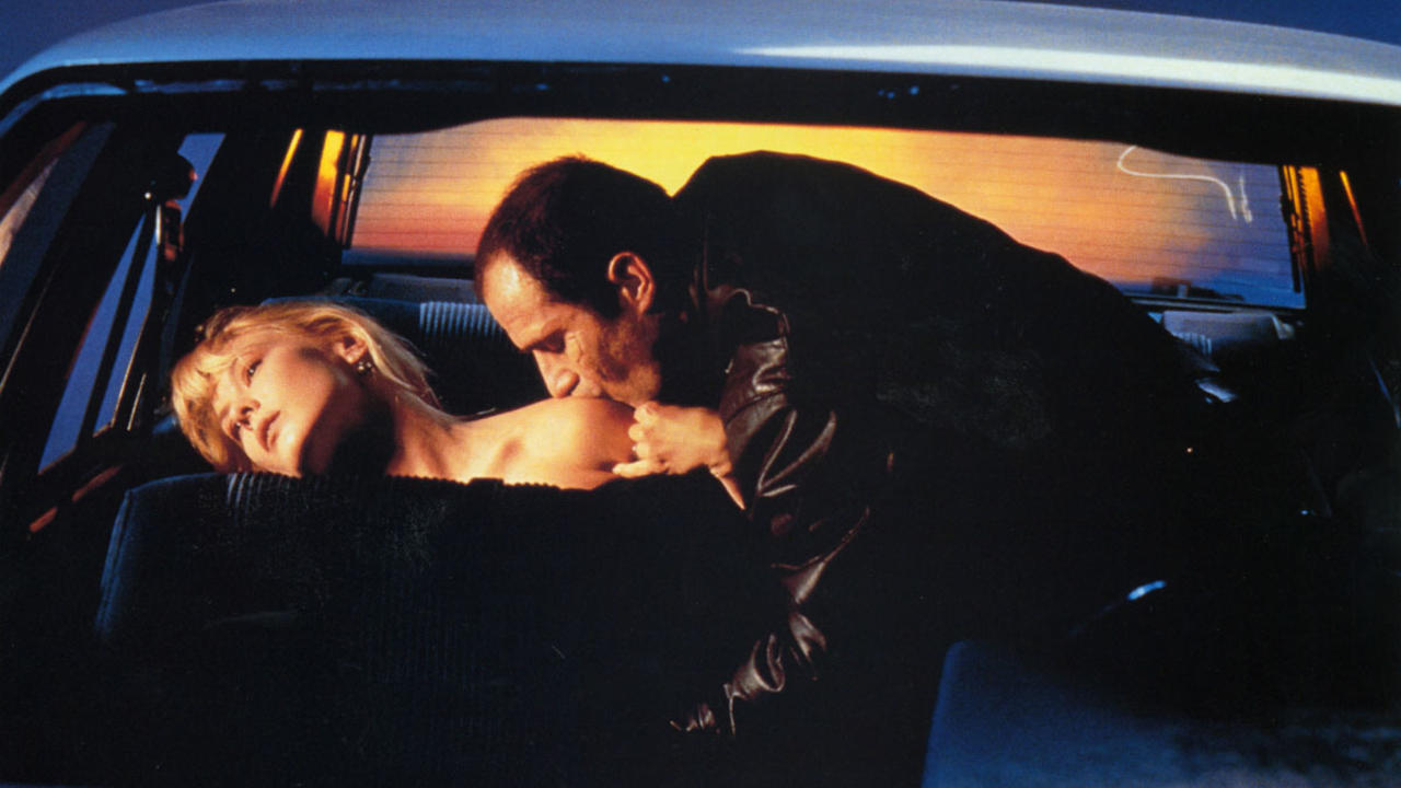 Elias Koteas ravages Deborah Kara Unger in the backseat of the car in Crash (1996)