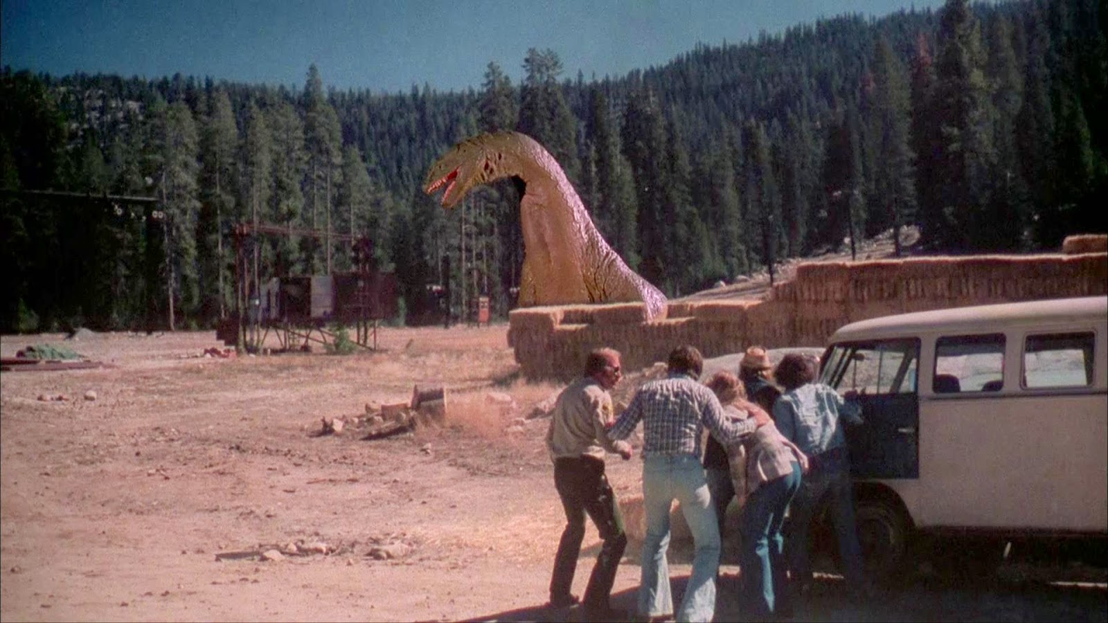 The stop-motion animated dinosaur emerges from the lake in The Crater Lake Monster (1977)