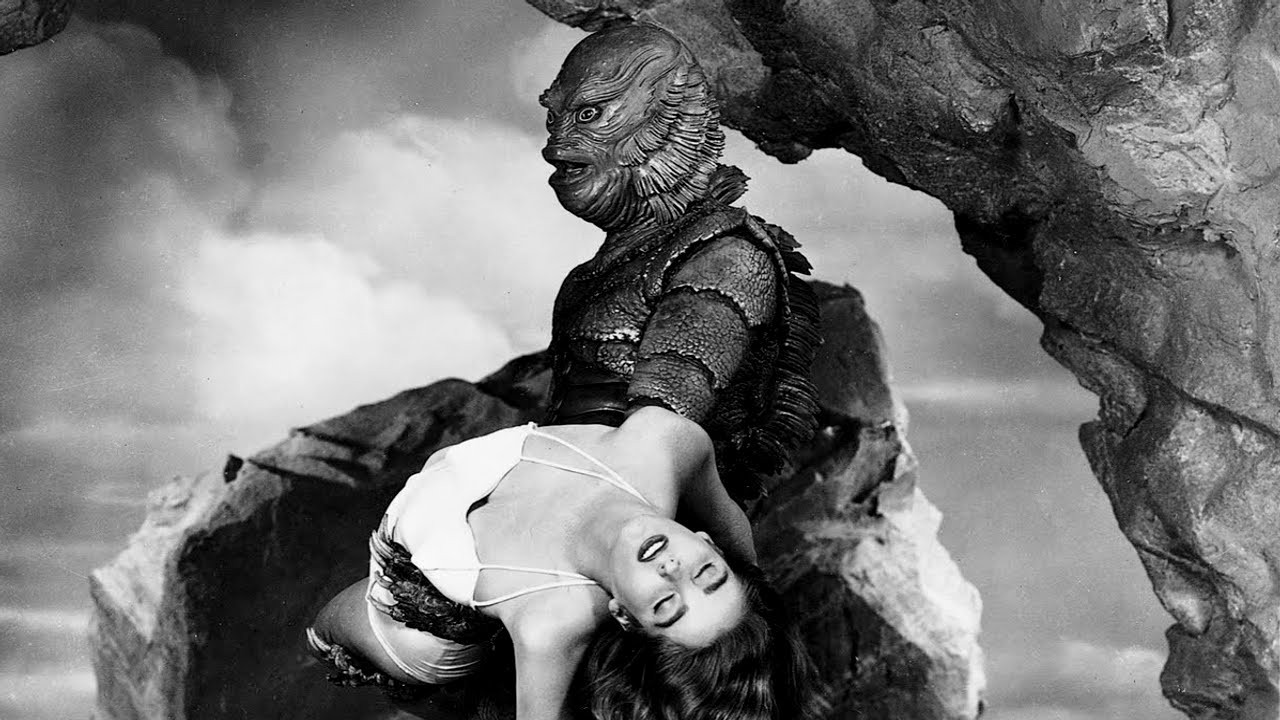 The Gill Man (Ben Chapman) abducts Julia Adams in The Creature from the Black Lagoon (1954)