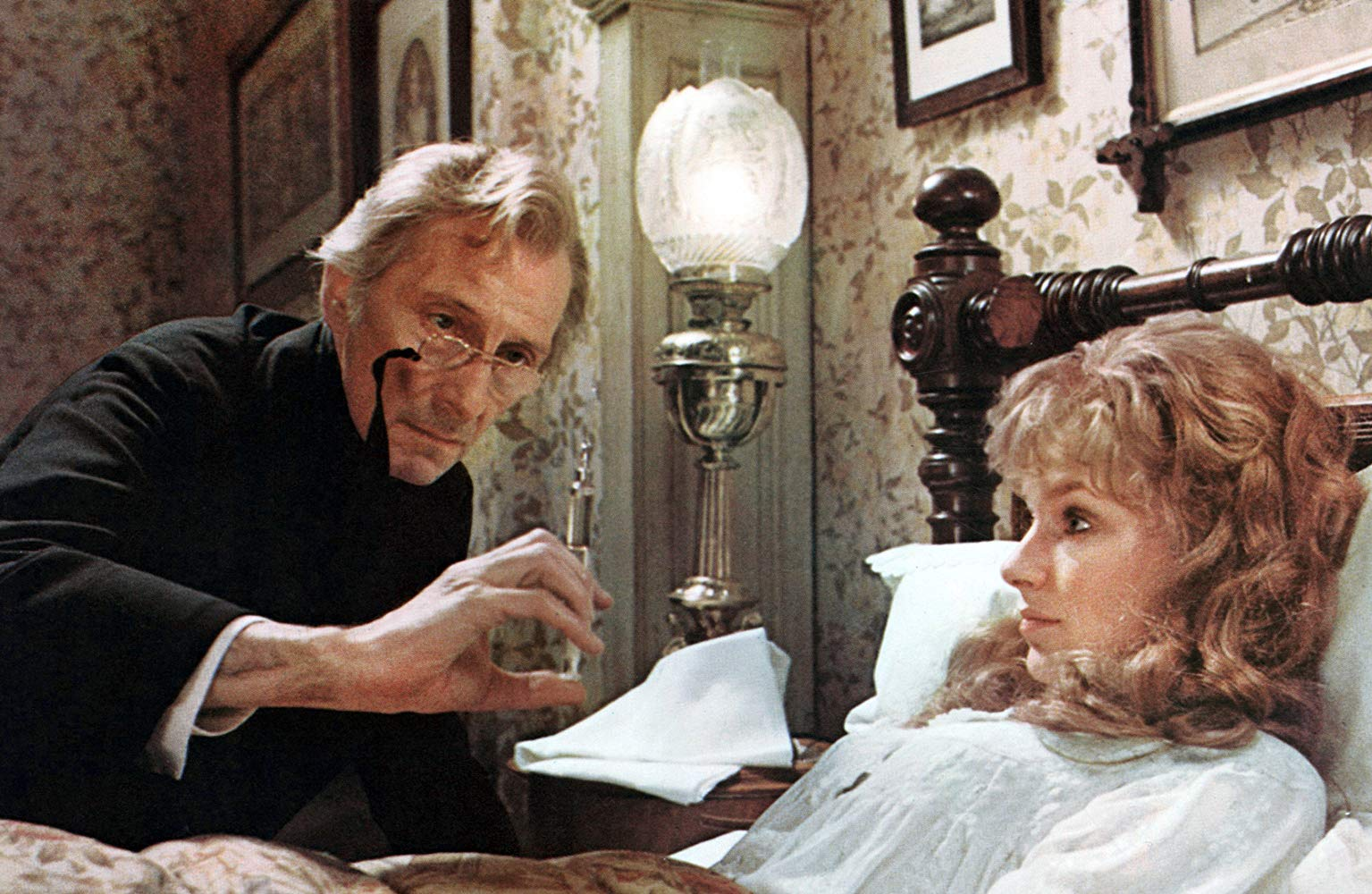 Peter Cushing injects daughter Lorna Helbron with the serum in The Creeping Flesh (1973)