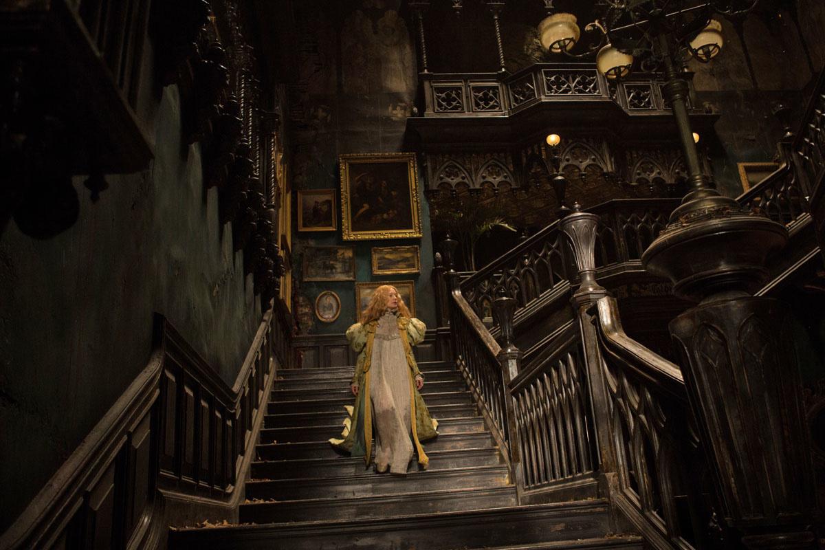 Mia Wasikowska comes down the stairs in Crimson Peak (2015)