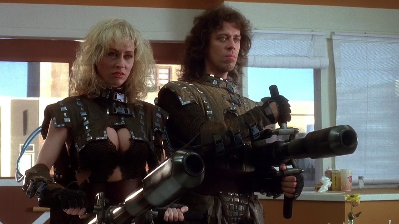 The return of intergalactic bounty hunters Ug (Terrence Mann) and Lee (Roxanne Kernohan) in Critters 2 (1988)