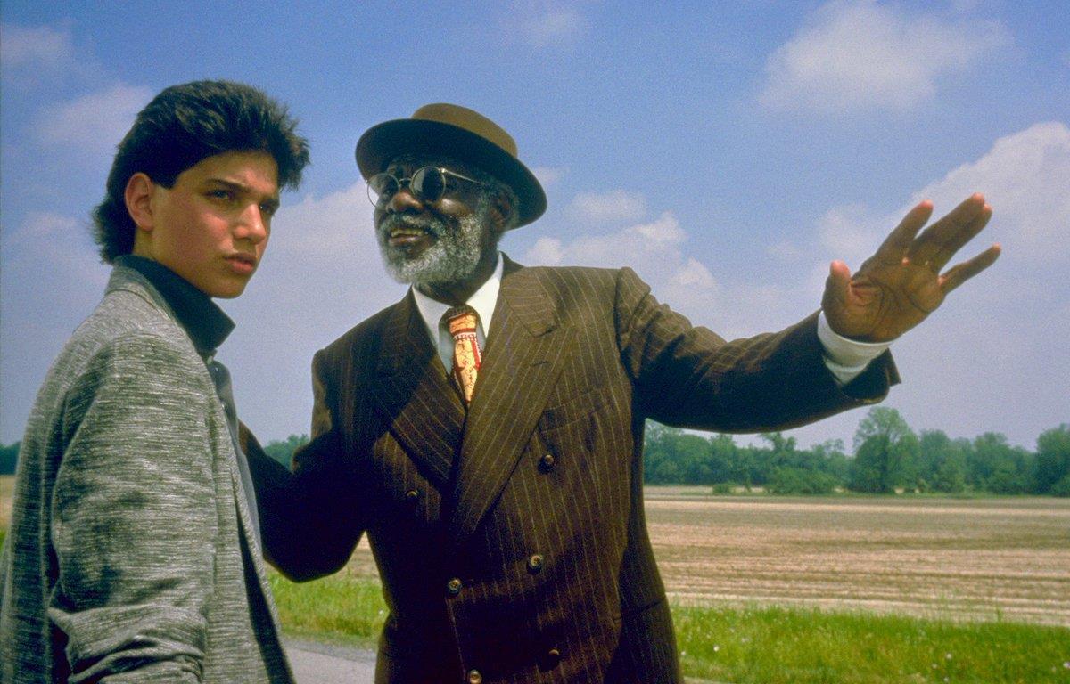 (l to r) Ralph Macchio and aging bluesman Joe Seneca in Crossroads (1986)