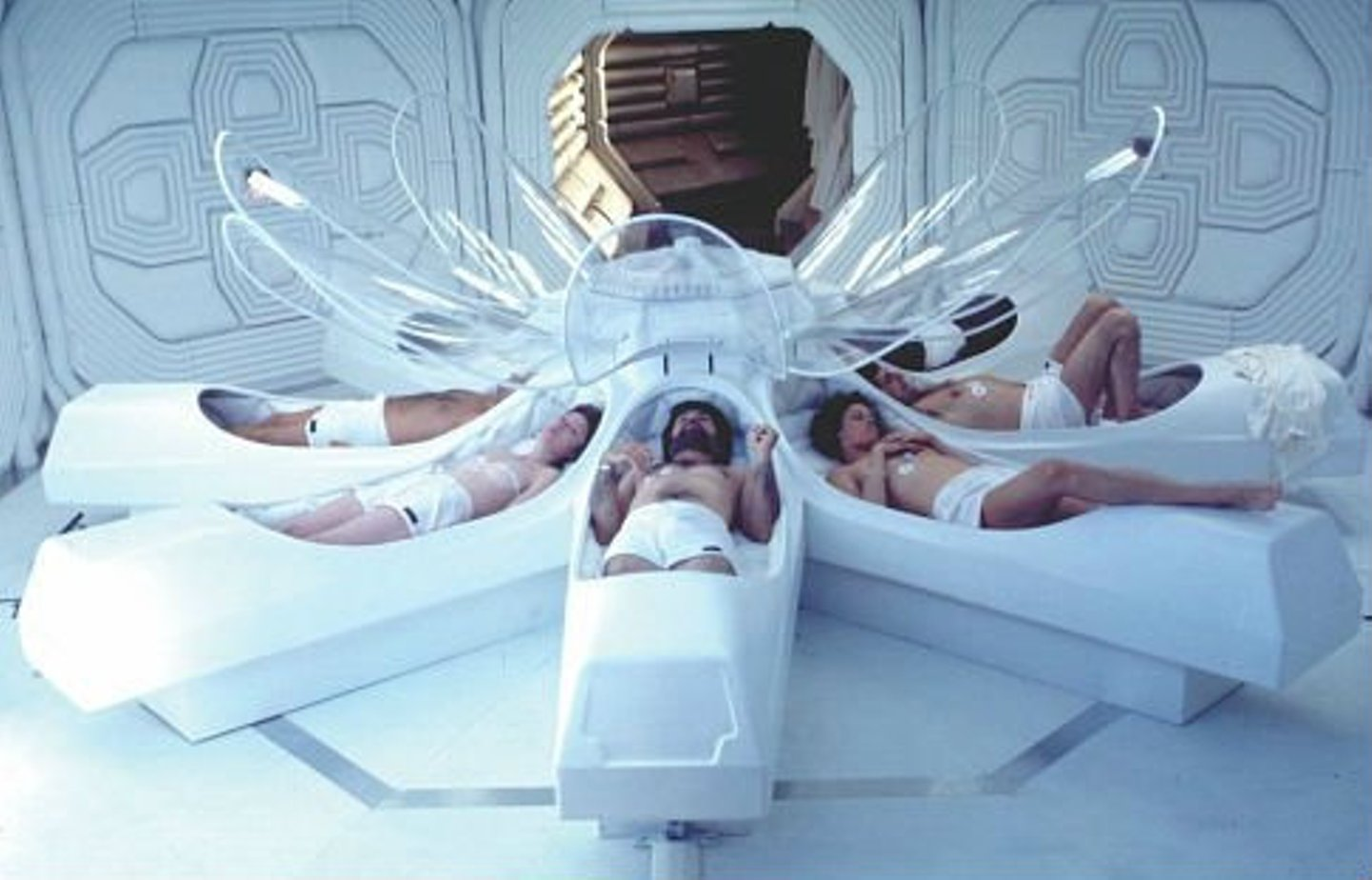 The crew of the Nostromo awake from cryogenic hypersleep in Alien (1979)