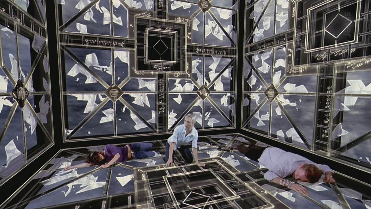 Trapped in a hyper-dimensional labyrinth - (l to r) Grace Lynn Kung, Kari Matchett and Geraint Wyn Davies in Cube 2: Hypercube (2002)