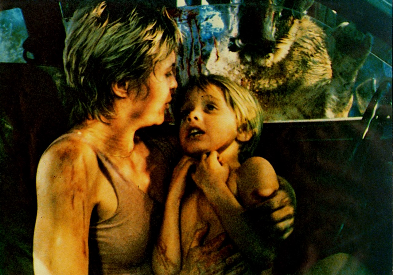 Dee Wallace and Danny Pintuaro trapped in a car by Cujo