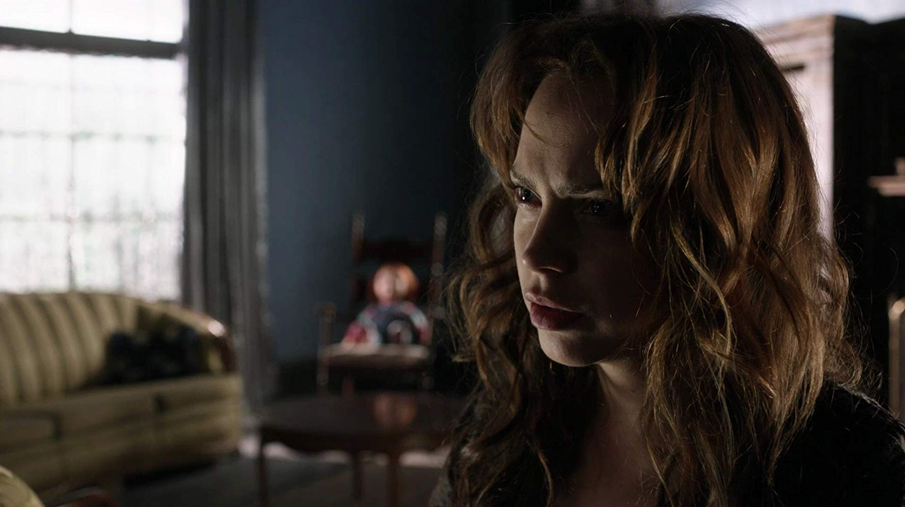 Brad Dourif's daughter Fiona with Chucky in the background in Curse of Chucky (2013)