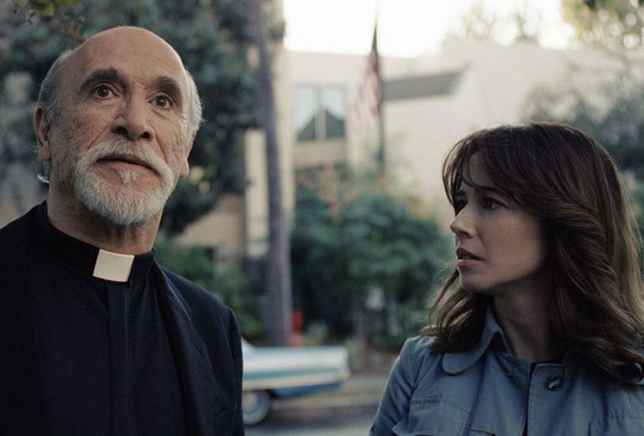 Linda Cardellini and Tony Amendola as Father Perez who connects up to the rest of The Conjuring Universe in The Curse of La Llorona (2019)