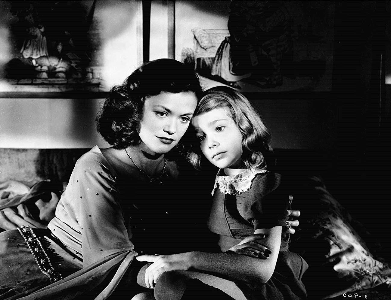Simone Simon comforts young Ann Carter in The Curse of the Cat People (1944)