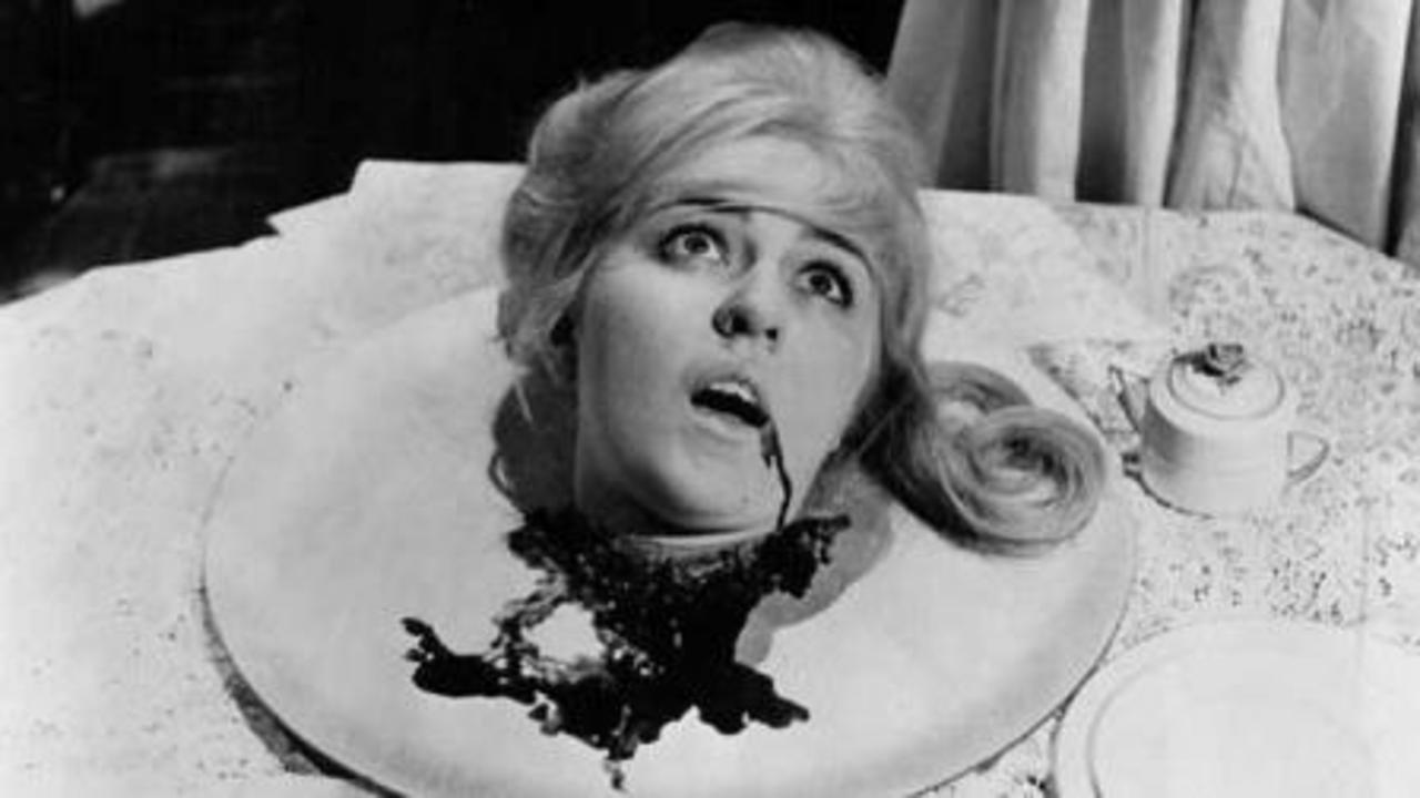Linda Donovan's severed head on a platter in The Curse of the Living Corpse (1964)