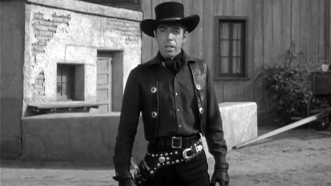 Michael Pate as the vampire gunslinger Drake Robey in Curse of the Undead (1959)
