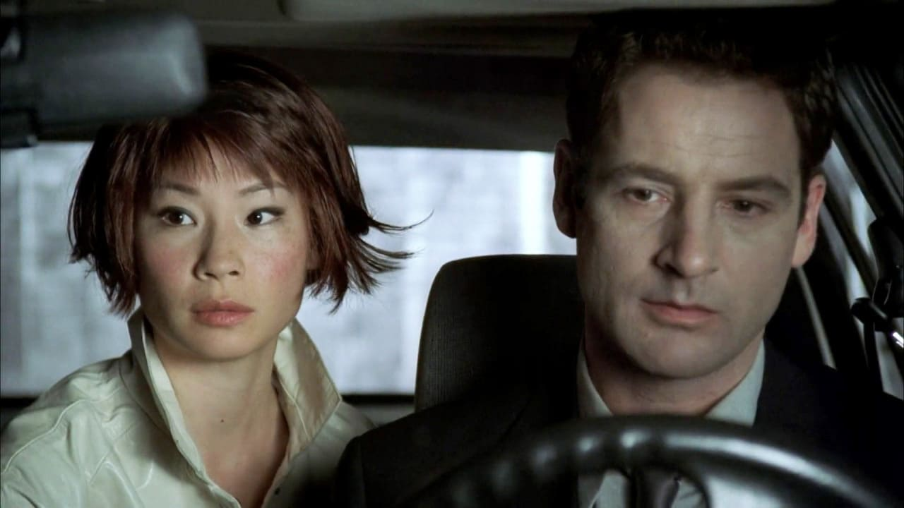 Jeremy Northam and Lucy Liu in Cypher (2002)