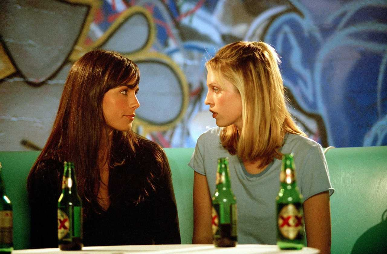 Lesbian attraction between Lucy Diamond (Jordana Brewster) and Amy (Sara Foster) in D.E.B.S. (2004)
