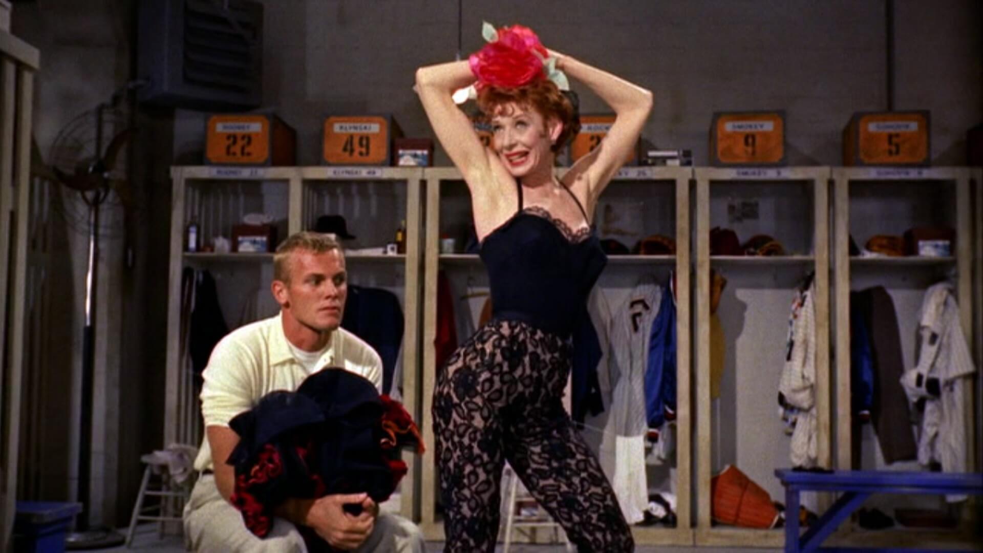 Lola (Gwen Verdon) tempts Joe Hardy (Tab Hunter) in Damn Yankees (1958)