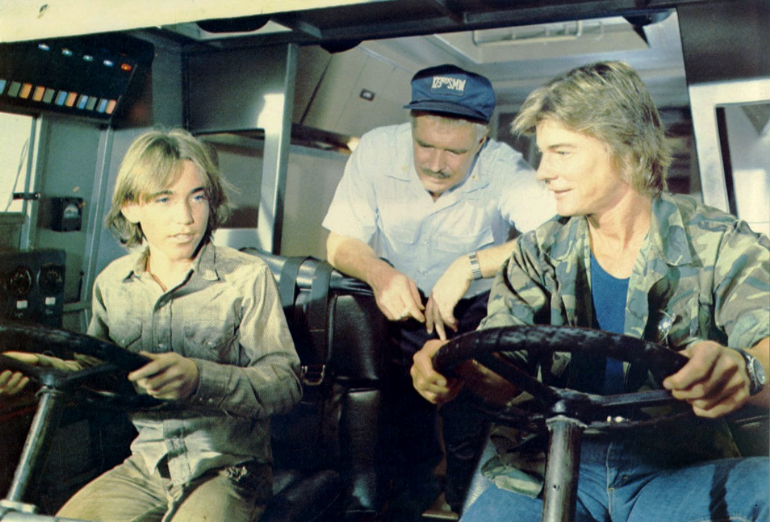 Jackie Earl Harley, George Peppard and Jan-Michael Vincent at the controls of The Landmaster in Damnation Alley (1977)