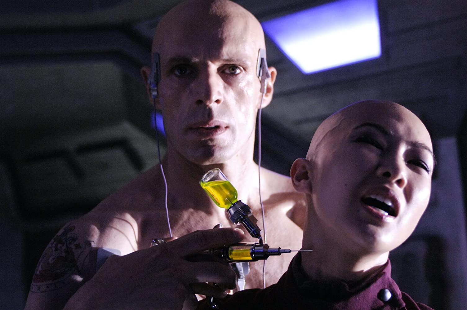 Saint-Georges (Lambert Wilson) holds Elisa (Linh-Dan Pham) prisoner in Dante 01 (2008)