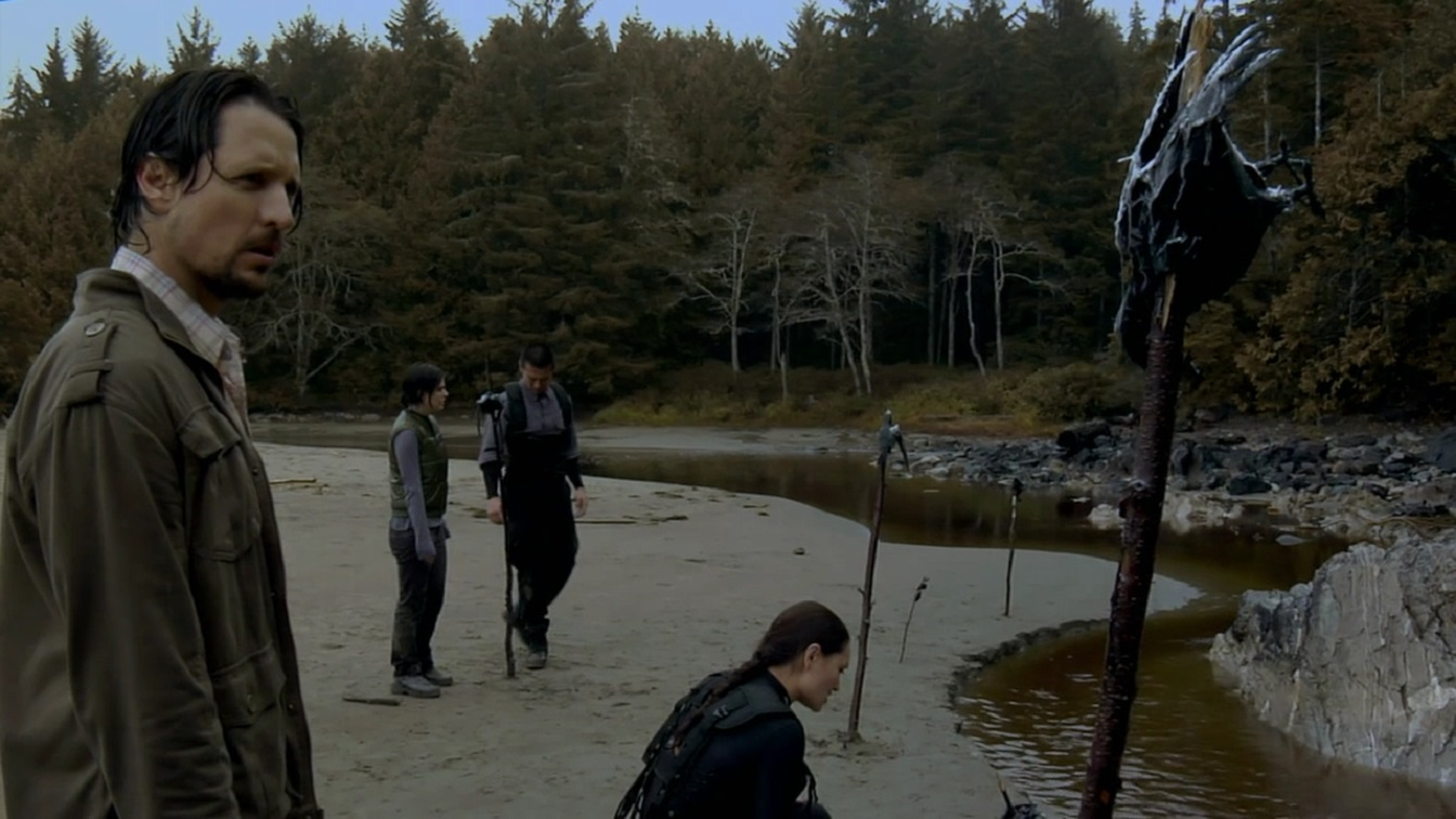 The investigators on the island ponder the significance of the dead crows in Dark Island (2010)