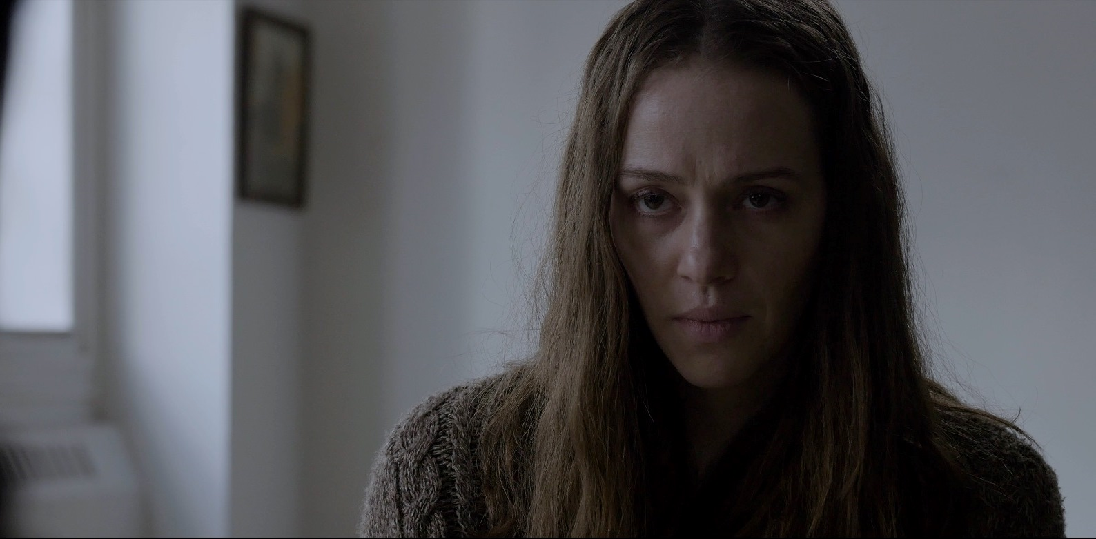 Asylum inmate Sybil (April Billingsley) in The Dark Red (2019)