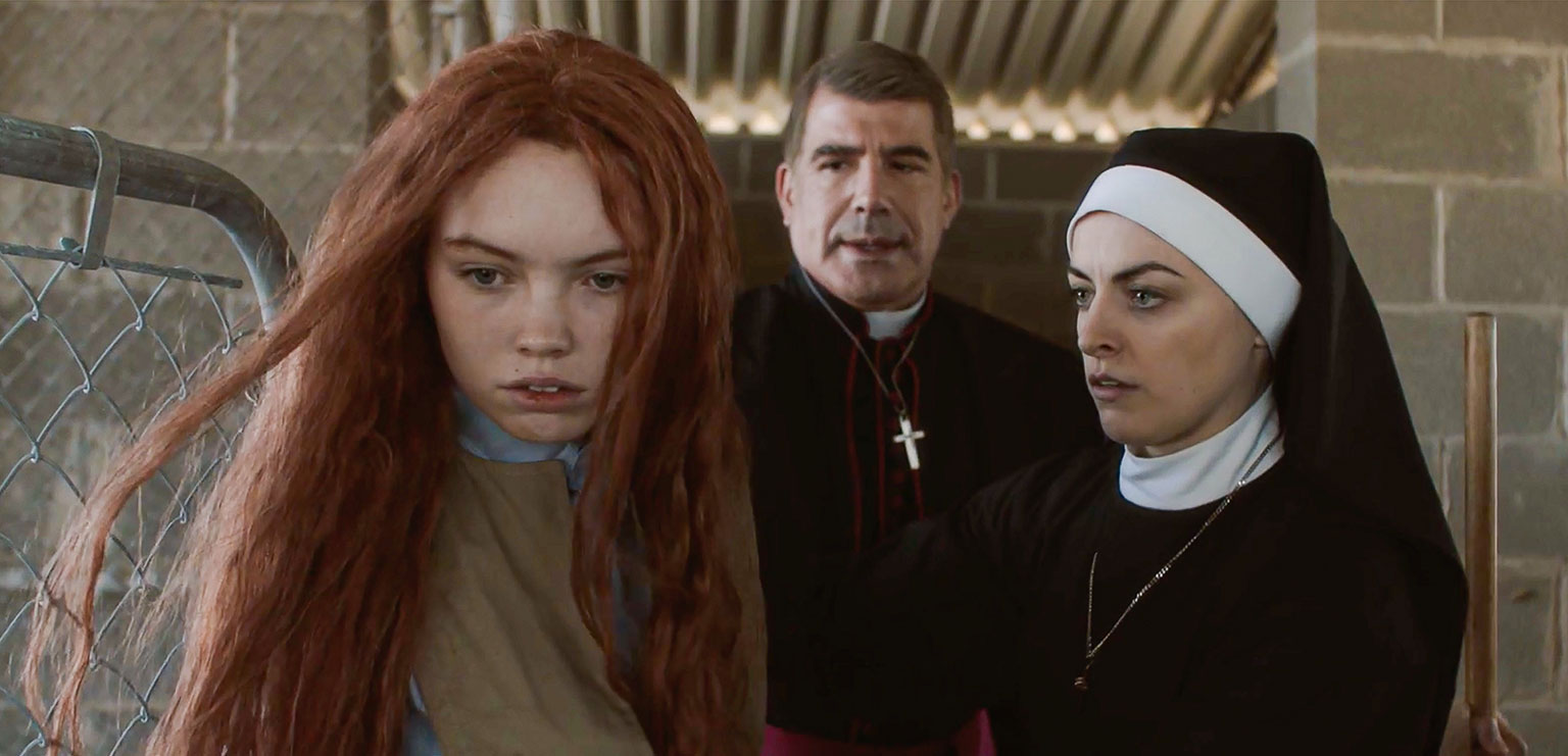 Darlin' (Lauryn Canny), The Bishop (Bryan Batt) and Sister Jennifer (Nora-Jane Noone) in Darlin' (2019)
