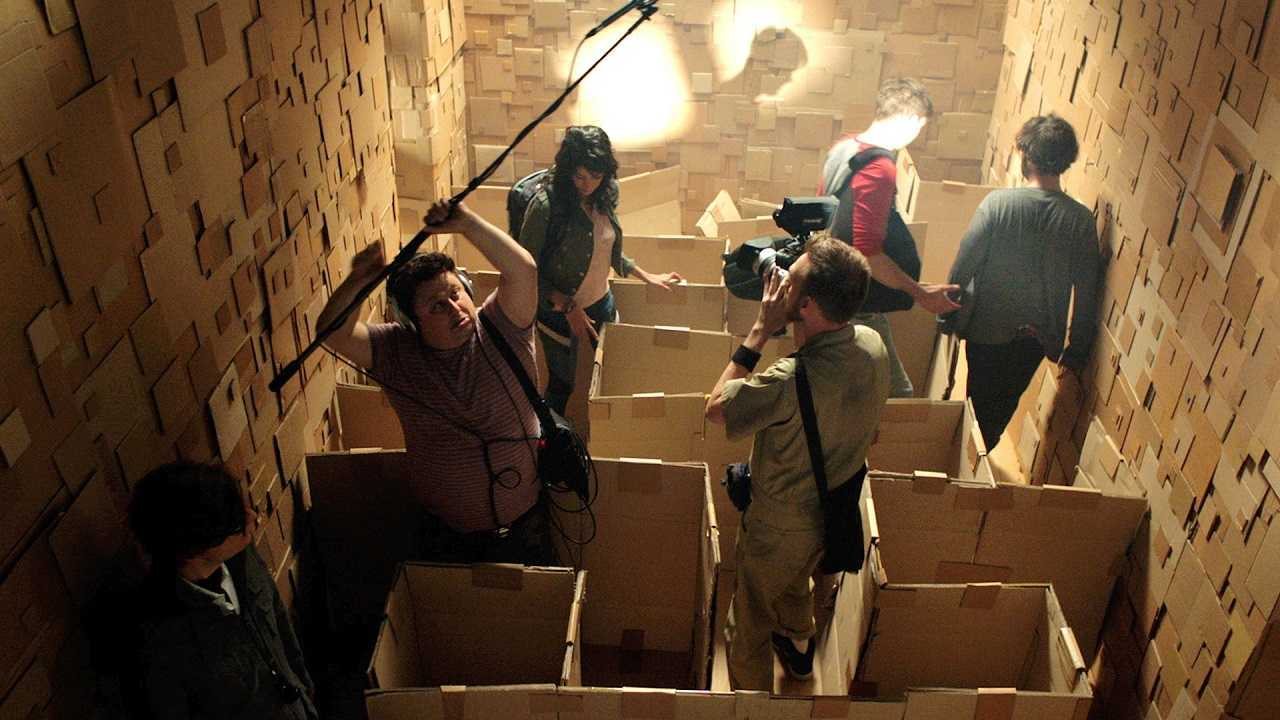 The film crew navigate the inside of the cardboard maze in Dave Made a Maze (2017)