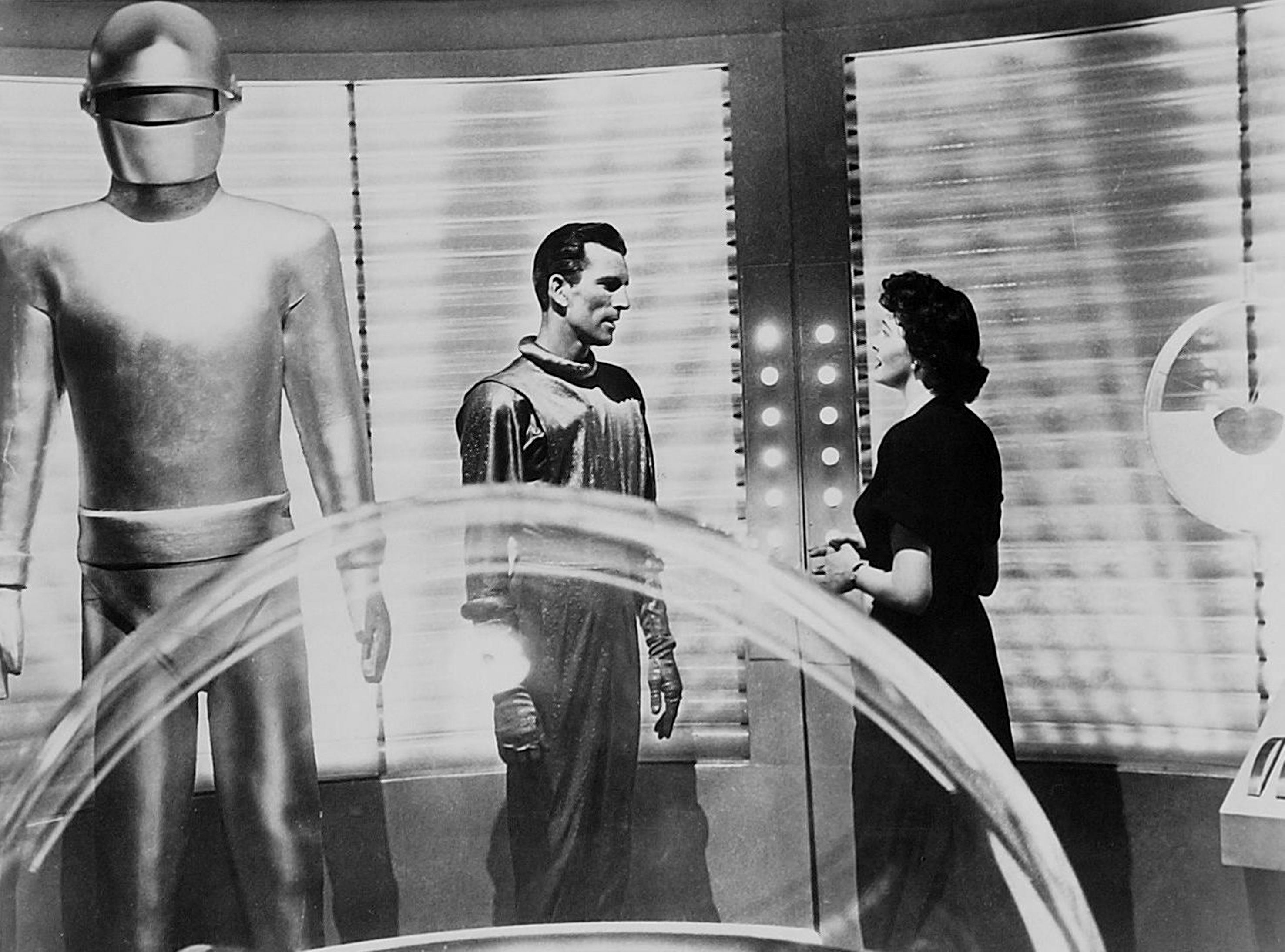 Gort (Lock Martin), Klaatu (Michael Rennie) and Helen Benson (Patricia Neal) inside the saucer in The Day the Earth Stood Still (1951)