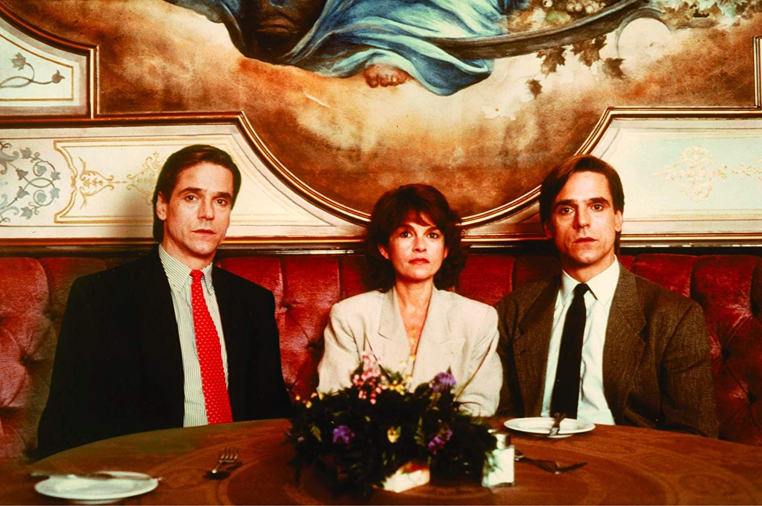 Jeremy Irons as the Mantle twins with Genevieve Bujold in Dead Ringers (1988)