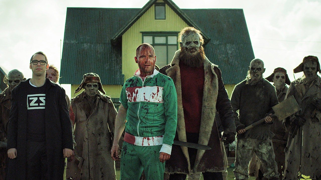 The local defenders - (l to r front) Daniel (Martin Starr) from the Zombie Squad, returning hero Vegar Hoel and Derek Mears (with beard) as the Soviet commander Lieutenant Stavarin and assorted Soviet zombies in Dead Snow 2 (2014)