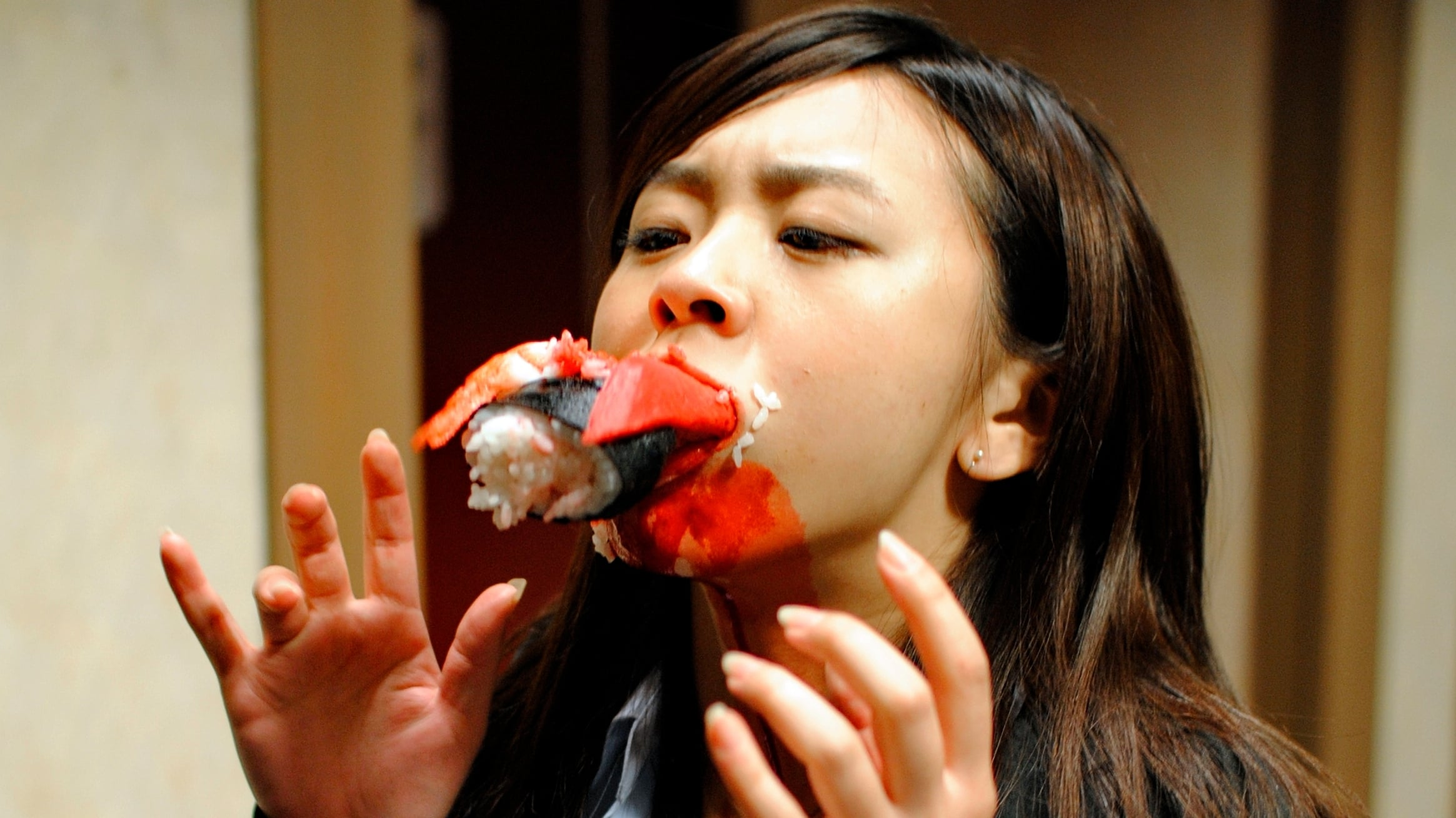 Attack by killer sushi in Dead Sushi (2012)