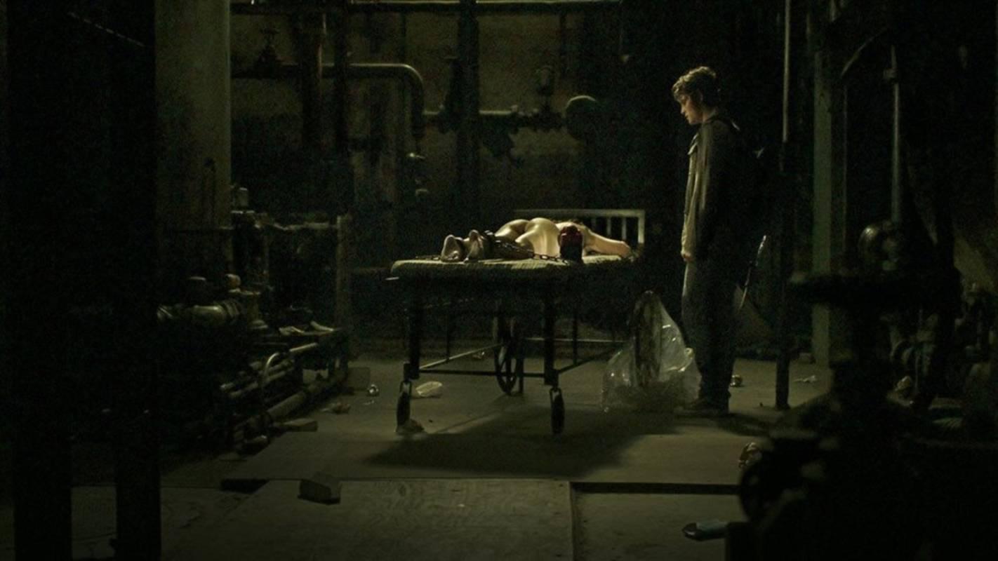 Noah Segan with imprisoned Deadgirl (Jenny Spain) on the bench