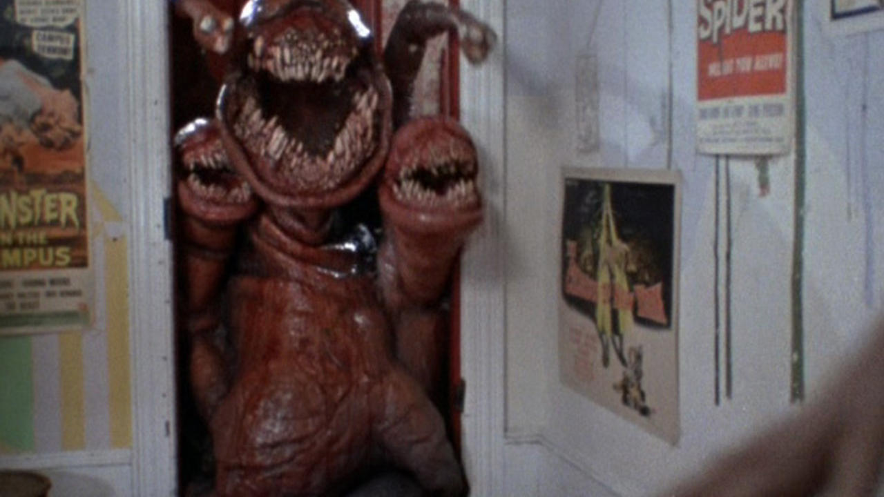 The alien creature invades a bedroom in The Deadly Spawn (1982)