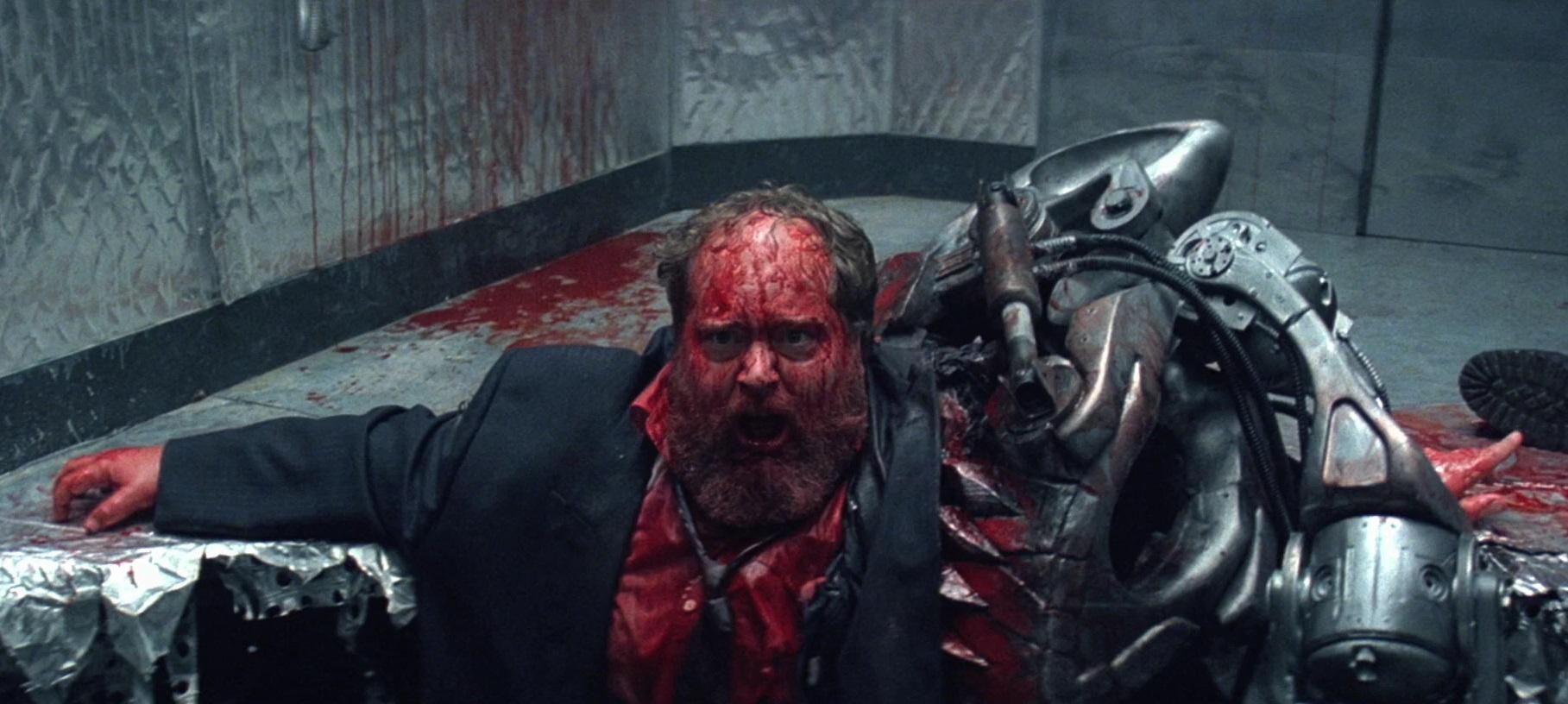 William Hootkins gets devoured by the Warbeast in Death Machine (1995)