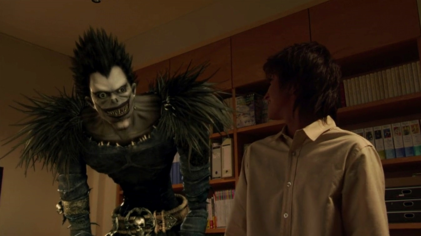 Light Turner (Nat Wolff) and the death god Ryuk in Death Note (2017)