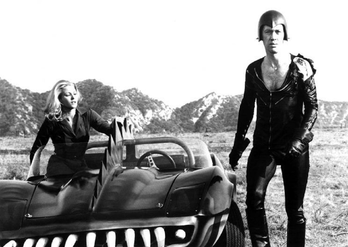 Frankenstein (David Carradine) with his co-driver Simone Griffeth in Death Race 2000 (1975)