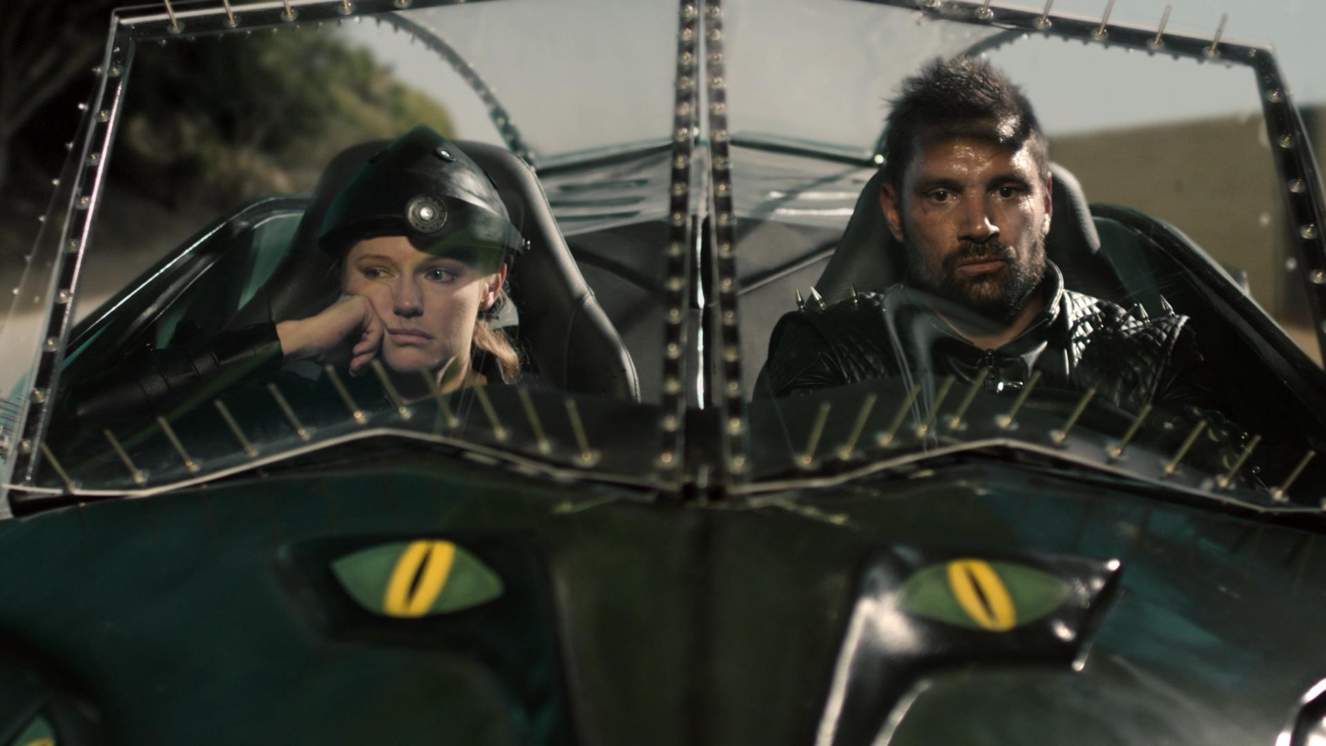 Frankenstein (Manu Bennett) and his passenger Annie Sullivan (Marci Miller) in Death Race 2050 (2017)