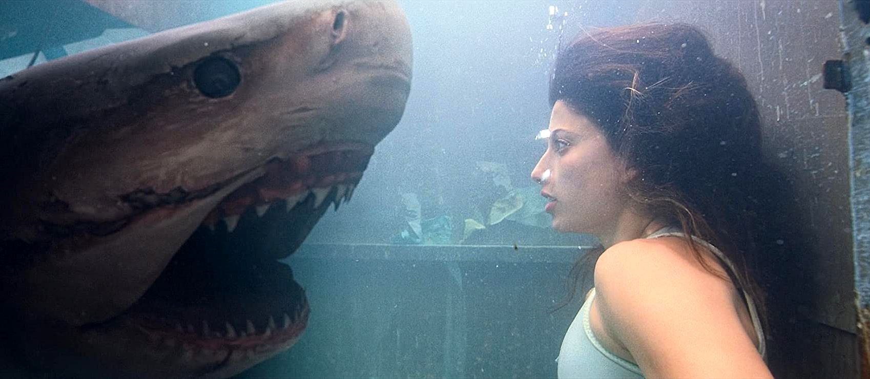 Tania Raymonde faces a shark while trapped inside a garbage compactor in Deep Blue Sea 3 (2020)