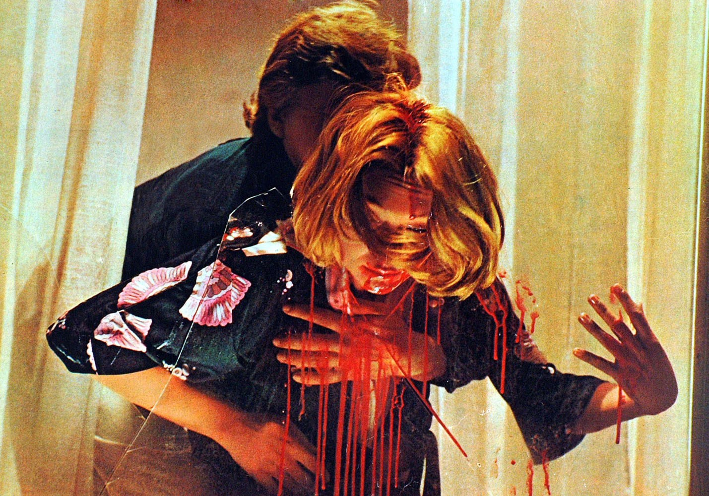 Psychic Macha Meril impaled on the glass of a broken window in Deep Red (1976)