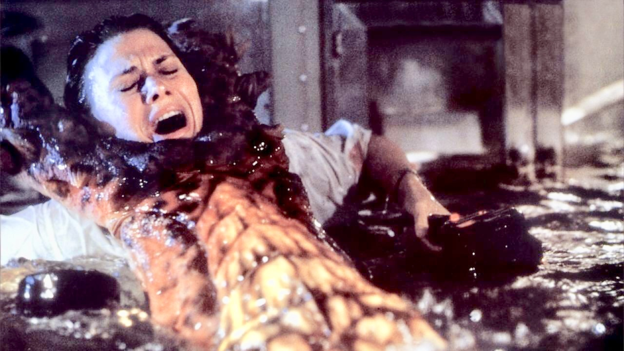 Cindy Pickett under attack by the monster in Deepstar Six (1989)