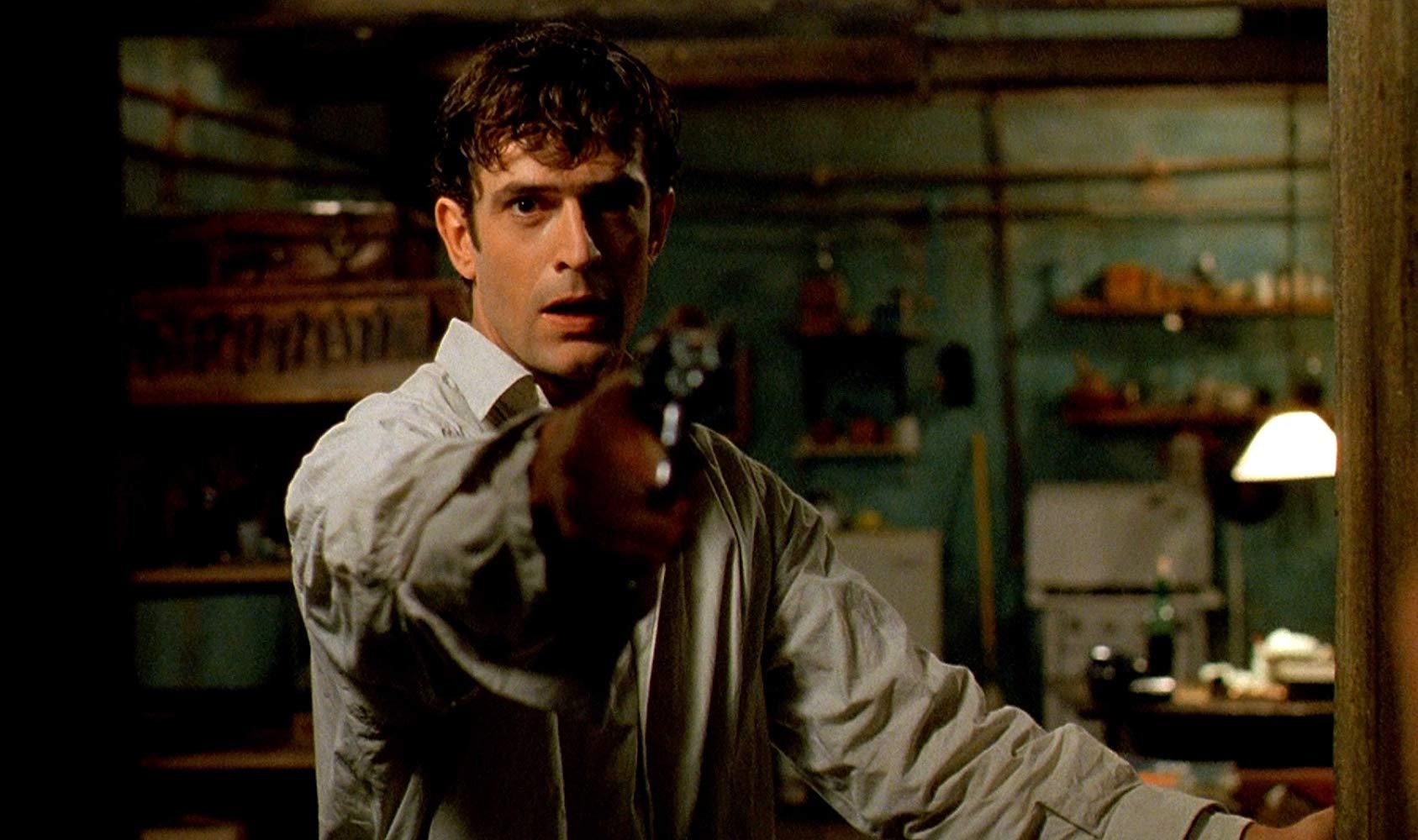 Rupert Everett as cemetery keeper Francesco Dellamorte in Dellamorte Dellamore (1994)