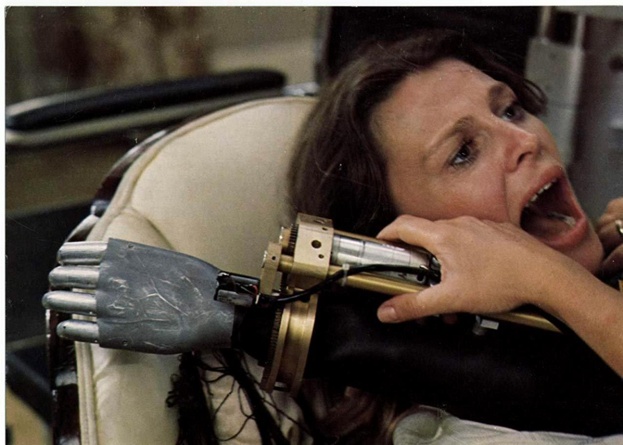 Julie Christie held prisoner by the robotic arm of a computer-controlled wheelchair in Demon Seed (1977)