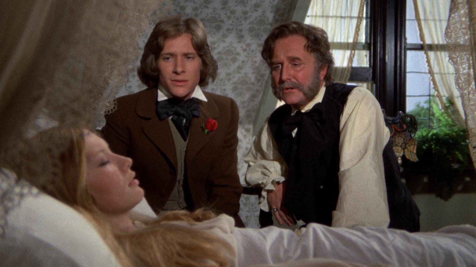 (l to r) Paul Jones and Robert Hardy try to find aid for the madness that infects Gillian Hills in Demons of the Mind (1972)
