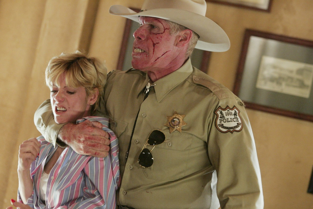Collie Entragian (Ron Perlman) menaces Sylva Kelegian in Desperation (2006)