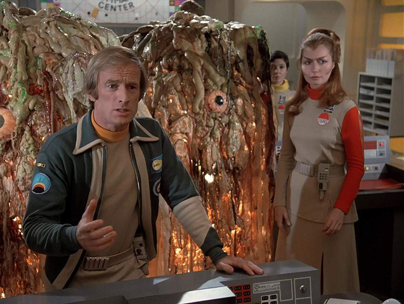 Alan Carter (Nick Tate), Sandra Benes (Zienia Merton) and Maya (Catherine Schell) surrounded by the aliens in Destination Moonbase-Alpha (1979)