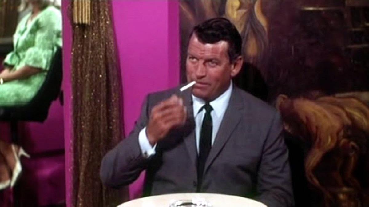 Richard Egan as payboy Dan Street in The Destructors (1968)
