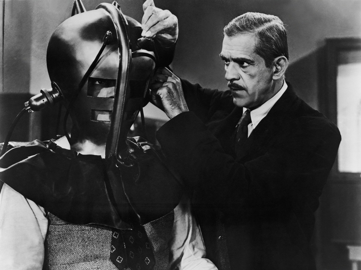 Boris Karloff straps a subject into the brainwave recording device in The Devil Commands (1941)