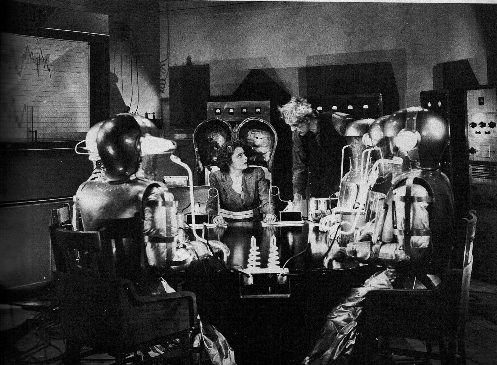 Boris Karloff stands over Anne Revere surrounded by a tableful of corpses as he prepares to conduct his experiment in The Devil Commands (1941)